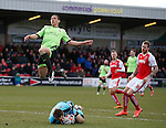 Che Adams of Sheffield Utd leaps over Chris Maxwell of Fleetwood Town as he collects the ball - English League One - Fleetwood Town vs Sheffield Utd - Highbury Stadium - Fleetwood - England - 5rd March 2016 - Picture Simon Bellis/Sportimage