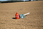 Scatterer gas canister bird scarer on farmland, Sutton, Suffolk, England, UK