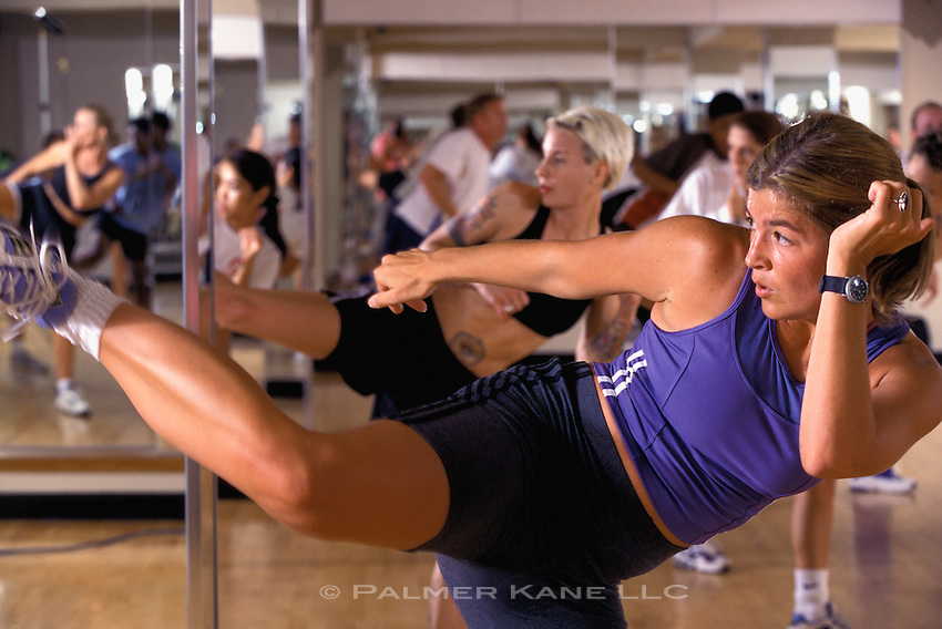 Woman works out in Tae Bo class