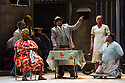 London, UK. 10.07.2012. Cape Town Opera returns to the London Coliseum with their acclaimed production of Porgy and Bess. Picture shows:  Miranda Tini (Maria), Nonhlanhla Yende (Bess) and Xolela Sixaba (Porgy). Photo credit: Jane Hobson