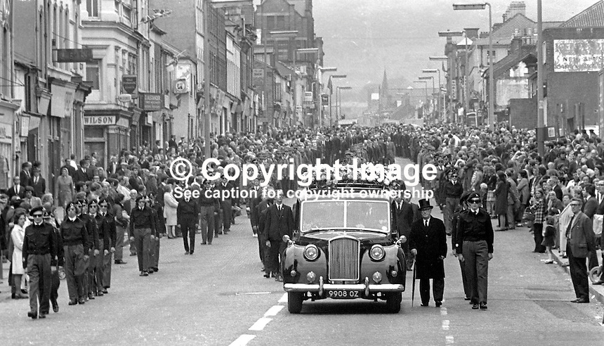 Ulster Defence Association-Loyalist Association of Workers paramilitary  funeral of James Johnston, a LAW official, who was found shot dead in a van in Turin Street off the Grosvenor Road, progresses down the Shankill Road, Belfast, N Ireland, 25th August 1972. His assasination was believed to have been carried out by the Provisional IRA. 197208250447a.<br /> <br /> Copyright Image from Victor Patterson, 54 Dorchester Park, Belfast, UK, BT9 6RJ<br /> <br /> t1: +44 28 9066 1296 (from Rep of Ireland 048 9066 1296)<br /> t2: +44 28 9002 2446 (from Rep of Ireland 048 9002 2446)<br /> m: +44 7802 353836<br /> <br /> e1: victorpatterson@me.com<br /> e2: victorpatterson@gmail.com<br /> <br /> The use of my copyright images is subject to my Terms &amp; Conditions.<br /> <br /> It is IMPORTANT that you familiarise yourself with them. They are available on my website at www.victorpatterson.com.<br /> <br /> None of my copyright images may be used on a website unless they are visibly watermarked, i.e. &copy; Victor Patterson within the body of the visible image. Metadata denoting my copyright must NOT be deleted. <br /> <br /> Web use is extra at currently recommended NUJ rates.