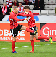 Lincoln City's Harry Anderson, left, with team-mate Declan O'Hare during the pre-match warm-up<br /> <br /> Photographer Chris Vaughan/CameraSport<br /> <br /> The EFL Sky Bet League Two Play Off First Leg - Lincoln City v Exeter City - Saturday 12th May 2018 - Sincil Bank - Lincoln<br /> <br /> World Copyright &copy; 2018 CameraSport. All rights reserved. 43 Linden Ave. Countesthorpe. Leicester. England. LE8 5PG - Tel: +44 (0) 116 277 4147 - admin@camerasport.com - www.camerasport.com