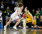 SIOUX FALLS, SD - MARCH 8: Lauren Loven #3 of the Denver Pioneers drives to the basket against an North Dakota State Bison defender at the 2020 Summit League Basketball Championship in Sioux Falls, SD. (Photo by Richard Carlson/Inertia)
