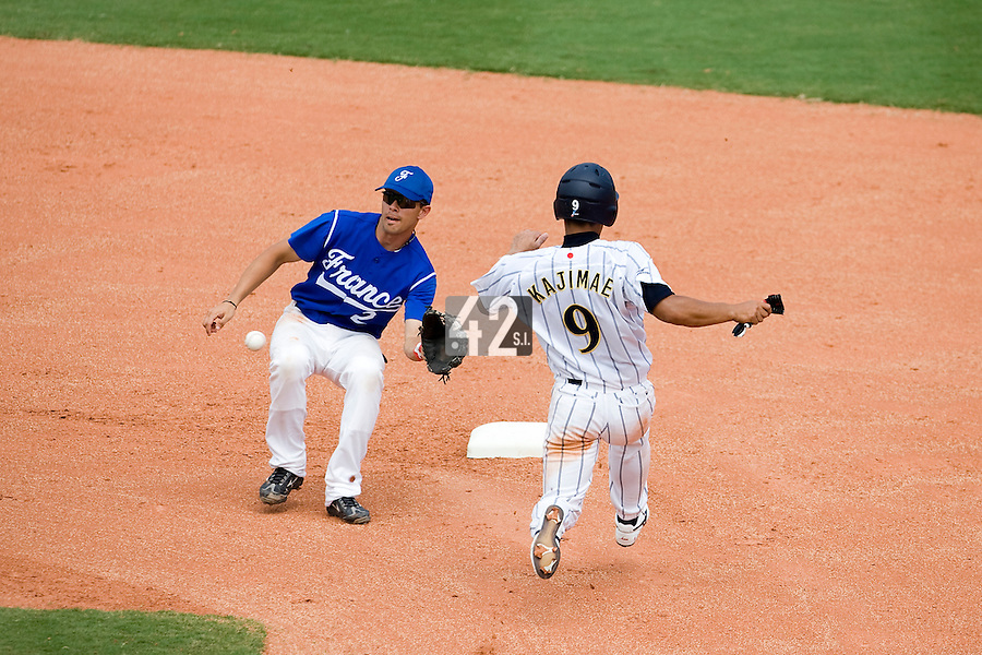 22 August 2007: France baseball team player Sebastien Herve catches a ball as Japanese Ryuichi Kajimae tries to steal the second base during the Japan 9-4 victory over France in the Good Luck Beijing International baseball tournament (olympic test event) at west Beijng's Wukesong Baseball Field in Beijing, China.