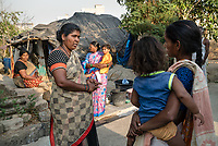 Rani Barukaum, the local SHG leader speaks with mothers about health issues and other safe drinking water habits in Ambedkar Nagar in Medak, Telangana, India.