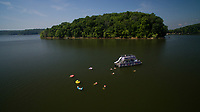 Boaters swim off of a pontoon on Lake Monroe near Bloomington, Indiana on Sunday, May 27, 2018. (Photo by James Brosher)