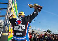 Jun 7, 2015; Englishtown, NJ, USA; NHRA top fuel driver Antron Brown celebrates after winning the Summernationals at Old Bridge Township Raceway Park. Mandatory Credit: Mark J. Rebilas-
