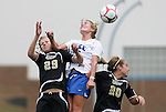28 August 2009: Duke's Elisabeth Redmond (center) heads the ball between Central Florida's Bianca Joswiak (29) and Stacie Hubbard (20). The Duke University Blue Devils lost 3-2 to the University of Central Florida Knights at Fetzer Field in Chapel Hill, North Carolina in an NCAA Division I Women's college soccer game.