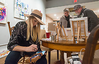 NWA Democrat-Gazette/BEN GOFF @NWABENGOFF<br /> Amy Eichler paints as Susan Zeh and husband Bruce Zeh of Bentonville look at some of her other paintings on display Thursday, Nov. 8, 2018, at Hark &amp; Herald Collaborative Space during the 'Light Up the Night!' one year anniversary Art on the Bricks art walk in downtown Rogers. More than 25 artists and musicians opened pop-up galleries selling their artwork at downtown shops and restaurants. Go Downtown Rogers hosts the walks on the second Thursday of each month.