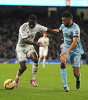 Picture: Andrew Roe/AHPIX LTD, Football, Barclays Premier League, Manchester City v Swansea City, 22/11/14, Etihad Stadium, K.O 3pm<br /> <br /> Swansea's Nathan Dyer keeps City's Gael Clichy at arms length<br /> <br /> Andrew Roe>>>>>>>07826527594