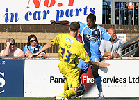 Gavin Grant of Wycombe Wanderers, former Gillingham and Millwall player is tackled by Dagenham's Peter Gain during Wycombe Wanderers vs Dagenham & Redbridge, Coca Cola League Division Two Football at Adams Park on 20th September 2008