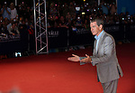 Pierce_Brosnan pose on the red carpet as they arrives for the screening of 'The November Man' during the 40th Deauville American Film Festival on September 5, 2014 in Deauville,
