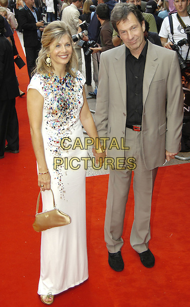 "GLYNIS BARBER & MICHAEL BRANDON.""King Arthur"" UK Premiere, Leicester Square, London,.15th July 2004..full length long white dress holding hands.Ref: PL.www.capitalpictures.com.sales@capitalpictures.com.©Capital Pictures."
