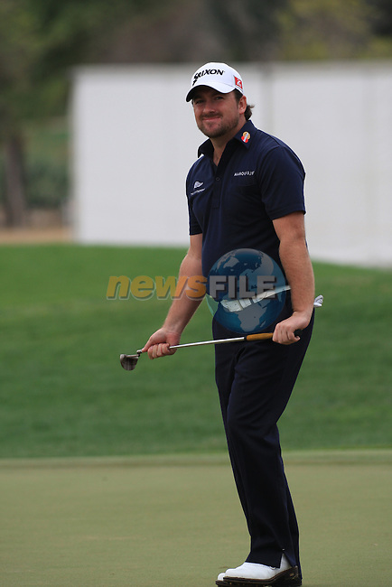 Graeme McDowell misses his putt on the 9th green on day two of the Abu Dhabi HSBC Golf Championship 2011, at the Abu Dhabi golf club, UAE. 21/1/11..Picture Fran Caffrey/www.golffile.ie.