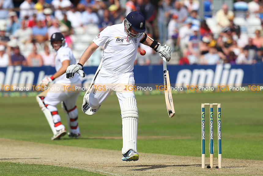 Graeme Swann of England is narrowly missed by the ball as Essex attempt his run out - Essex CCC vs England - LV Challenge Match at the Essex County Ground, Chelmsford - 30/06/13 - MANDATORY CREDIT: Gavin Ellis/TGSPHOTO - Self billing applies where appropriate - 0845 094 6026 - contact@tgsphoto.co.uk - NO UNPAID USE