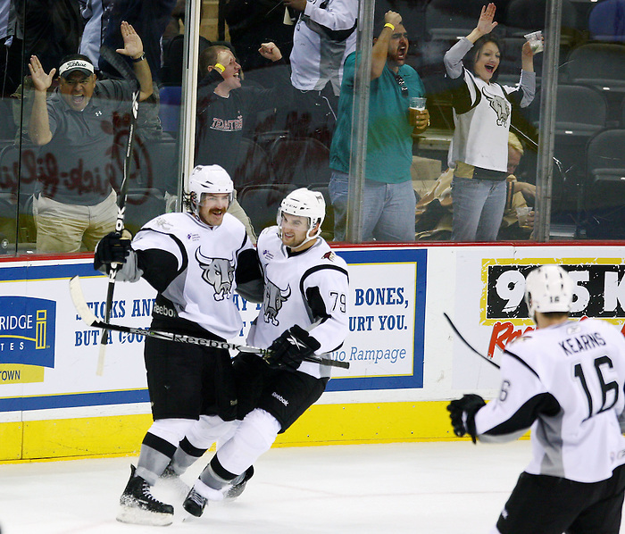 San Antonio Rampage's Ryan Hollweg, left, Brett MacLean, middle, and Bracken Kearns celebrate a third period empty-net goal by Hollweg as fans cheer during an AHL hockey game against the Lake Erie Monsters, Wednesday, Oct. 20, 2010, at the AT&T Center in San Antonio. (Darren Abate/pressphotointl.com)