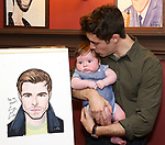 Elliott Michael Cott and Corey Cott during the Corey Cott Sardi's Portrait unveiling at Sardi's Restaurant on August 11, 2017 in New York City.