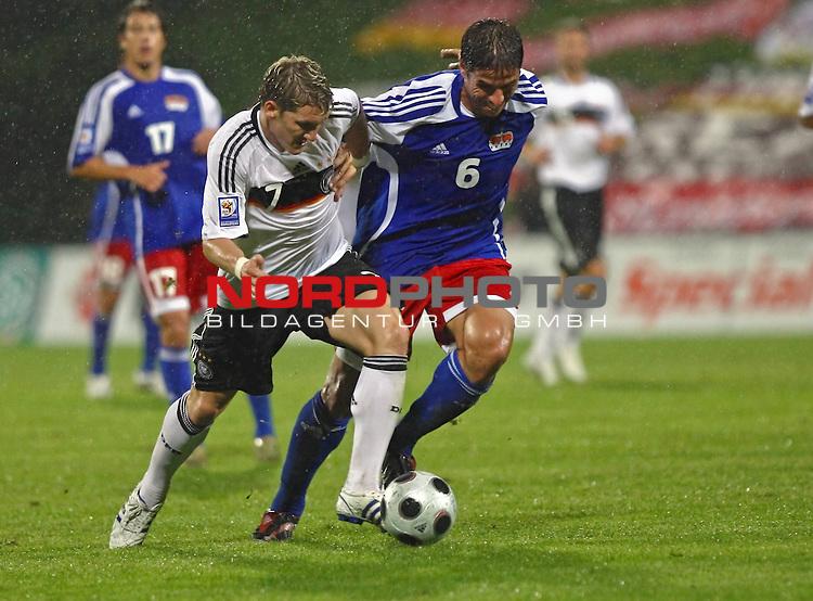WM-Qualifikation 2010<br /> Lichtenstein : Deutschland<br /> <br /> Bastian Schweinsteiger (Deutschland #7) gegen Martin Stocklasa (Lichtenstein #6)<br /> <br /> Foto &copy; nph (  nordphoto  )