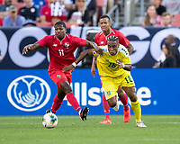CLEVELAND, OH - JUNE 22: Armando Cooper #11 and Neil Danns #16 go after the ball during a game between Panama and Guyana at FirstEnergy Stadium on June 22, 2019 in Cleveland, Ohio.