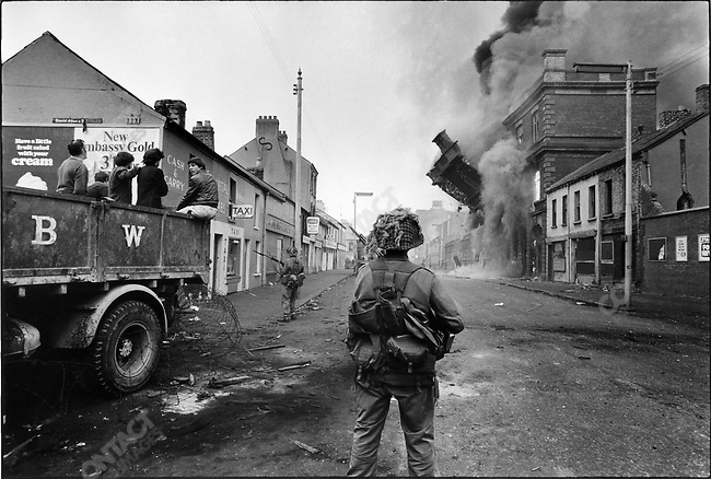 British soldiers patrol streets to control civil unrest after days of riots between Catholics and the Ulster police, Belfast, Northern Ireland, August 1969