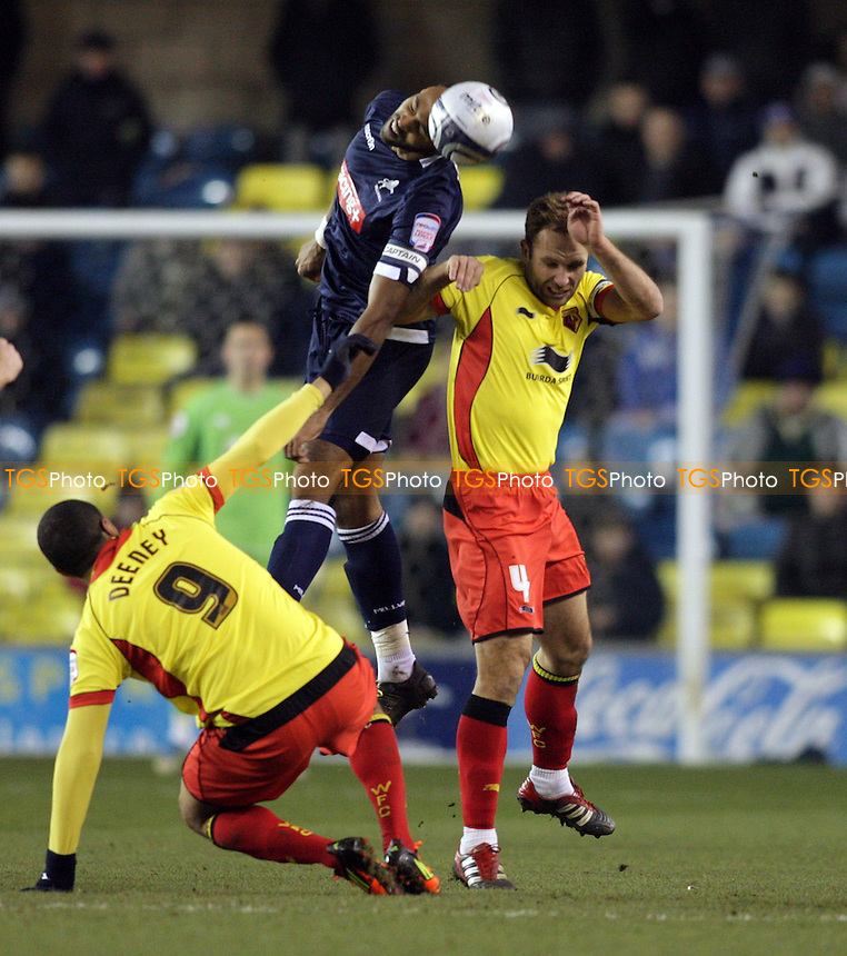 Liam Trotter of Millwall FC wins the ball over  John Eustace of Watford FC - Millwall vs Watford - nPower Championship Football at the New Den, London - 31/01/12 - MANDATORY CREDIT: Helen Watson/TGSPHOTO - Self billing applies where appropriate - 0845 094 6026 - contact@tgsphoto.co.uk - NO UNPAID USE.