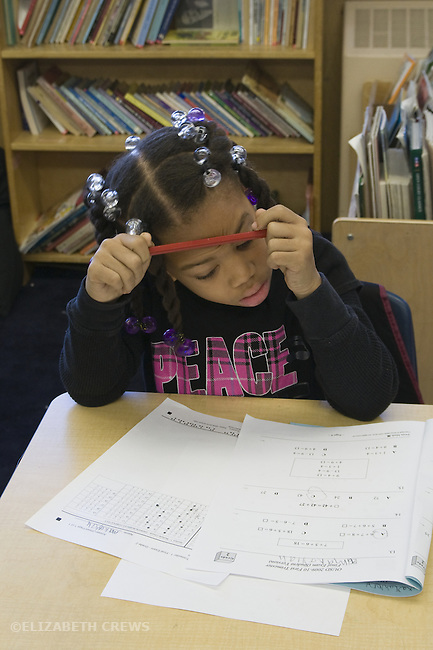 Oakland CA 2nd grade African American student taking standardized Oakland School District math test