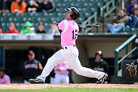 Rochester Red Wings outfielder Brian Dinkelman #12 during a game against the Columbus Clippers on May 12, 2013 at Frontier Field in Rochester, New York.  Rochester defeated Columbus 5-4 wearing special pink jerseys for Mother's Day.  (Mike Janes/Four Seam Images)