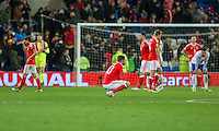 Wales players including Aaron Ramsey (centre) look dejected at full time of the FIFA World Cup Qualifying match between Wales and Serbia at the Cardiff City Stadium, Cardiff, Wales on 12 November 2016. Photo by Mark  Hawkins.