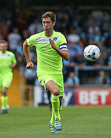 Luke Prosser of Colchester United in action during the Sky Bet League 2 match between Wycombe Wanderers and Colchester United at Adams Park, High Wycombe, England on 27 August 2016. Photo by Andy Rowland.