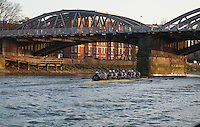 08.03.2014. River Thames, London, England.  The Oxford VIII pass under Chiswick Bridge during the OUBC v German VIII rowing fixture. <br /> The head to head race on the Tideway between Oxford University Boat Club VIII and a representative German VIII as part of the preparation for the 160th running of the University Boat Race sponsored by BNY Mellon on April 6th 2014.