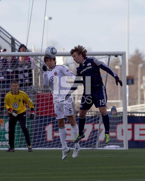 DC United defender Dejan Jakovic (5) and New England Revolution forward Zack Schilawski (15) battle for head ball. In a Major League Soccer (MLS) match, the New England Revolution defeated DC United, 2-1, at Gillette Stadium on March 26, 2011.