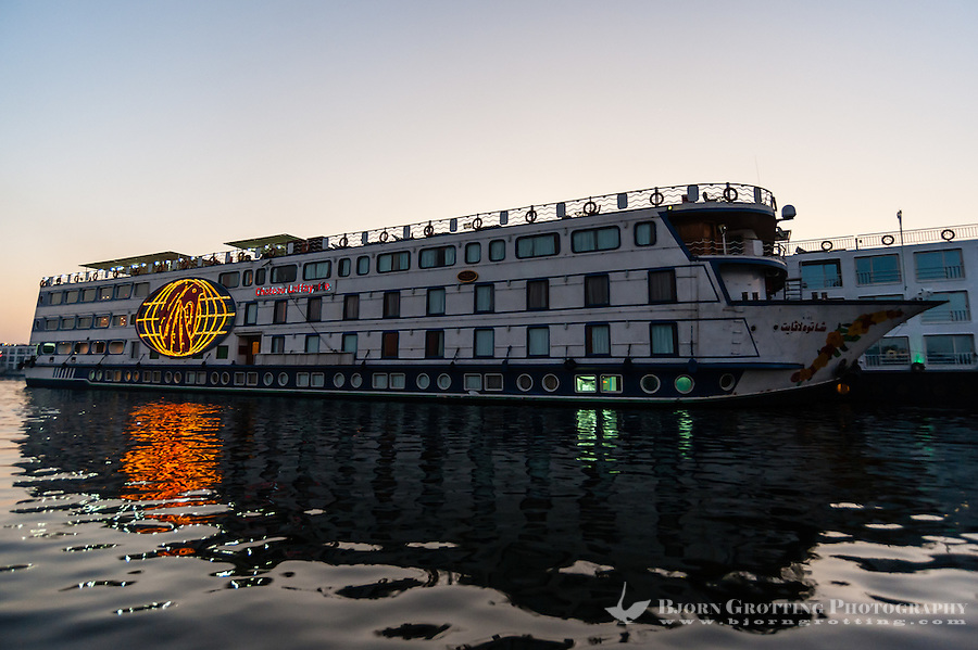 Sunrise in Luxor, Egypt. A riverboat, cruising the Nile.