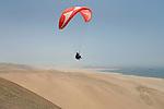 Paragliding in the Reserva Nacional de Paracas, Peru.