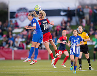 Boyds, MD - April 16, 2016: Washington Spirit midfielder Joanna Lohman (15) goes up for a header with Boston Breakers defender Whitney Engen (4). The Washington Spirit defeated the Boston Breakers 1-0 during their National Women's Soccer League (NWSL) match at the Maryland SoccerPlex.