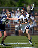 Boston College midfielder Mikaela Rix (17) drives for the net as Yale University defender Katherine Sherrill (14) defends. Boston College defeated Yale University, 16-5, at Newton Campus Field, April 28, 2012.
