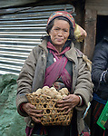A woman carries a basket of potatoes in the village of Gatlang, in the Rasuwa District of Nepal near the country's border with Tibet.