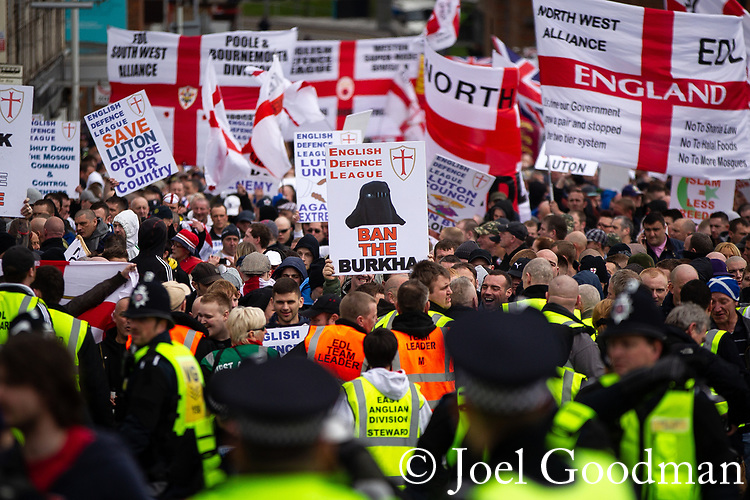 """© Joel Goodman - 07973 332324 . 05/05/2012 .  Luton , UK . A """" Ban the burkha """" placard is raised in the crowd . Approximately 1,500 people take part in an EDL ( English Defence League ) march in Luton , understood to have been policed by over 1,000 officers . Photo credit: Joel Goodman"""