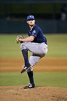 Asheville Tourists relief pitcher Bryan Baker (33) in action against the Kannapolis Intimidators at Kannapolis Intimidators Stadium on May 5, 2017 in Kannapolis, North Carolina.  The Tourists defeated the Intimidators 5-1.  (Brian Westerholt/Four Seam Images)