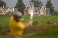 July 4th, 2006. Smurfit Kappa European Open 2006, Straffan, Kildare..Miguel Angel Jimenez practises at the above while in the background on site accommodation built on some of the most expensive real estate in Ireland, and depending on who you talk to cost from 1,000,000 upwards per unit..Photo: BARRY CRONIN/Newsfile..(Photo credit should read BARRY CRONIN/NEWSFILE).