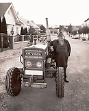 AUSTRIA, Joie, winemaker Willi Wetschka stands by his tractor at his winery in Joie, Burgenland (B&W)