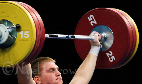 11 DEC 2011 - LONDON, GBR - Dmitriy Kaplan (KAZ) lifts during the men's +105kg category Snatch of the London International Weightlifting Invitational and 2012 Olympic Games test event held at the ExCel Exhibition Centre in London, Great Britain .(PHOTO (C) NIGEL FARROW)