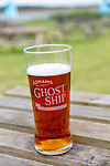 A pint glass of Adnams Ghost Ship pale ale beer on pub garden table, Suffolk, England, UK
