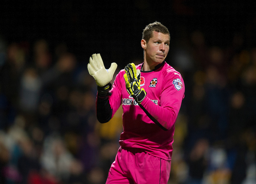 Cambridge United's goalkeeper Chris Dunn celebrates his teams 1-0 victory at the final whistle<br /> <br /> Photographer Stephen White/CameraSport<br /> <br /> Football - FA Challenge Cup First Round - Cambridge United v Fleetwood Town - Saturday 8th November 2014 - R Costings Abbey Stadium - Cambridge<br /> <br />  &copy; CameraSport - 43 Linden Ave. Countesthorpe. Leicester. England. LE8 5PG - Tel: +44 (0) 116 277 4147 - admin@camerasport.com - www.camerasport.com