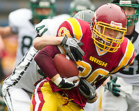 O'Dea Senior Michael Martin (20) is tackled by Peninsula Junior Luke Plummer (41) at Memorial Stadium in Seattle, Washington, on Saturday, November 6, 2010. O'Dea won the game 21-7.