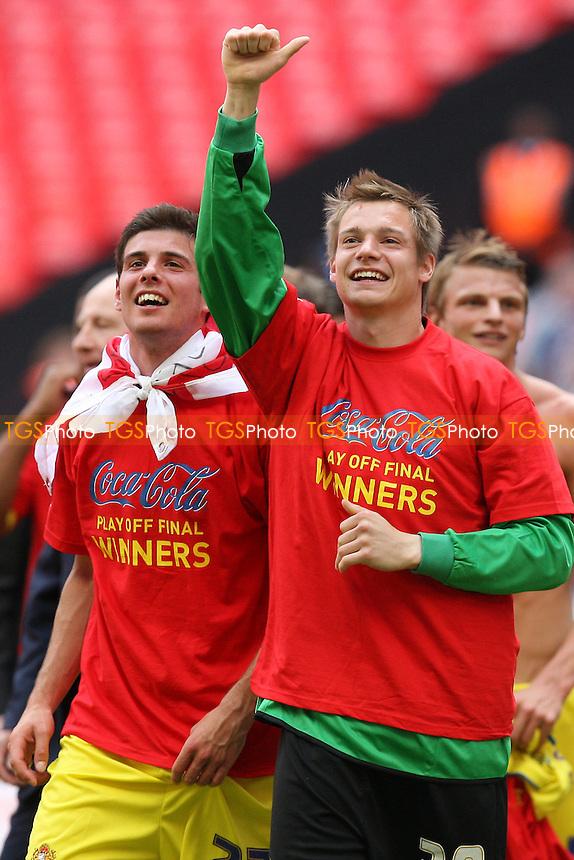 Daggers players celebrate at the final whistle - Dagenham & Redbridge vs Rotherham United - Coca Cola League Two Play-Off Final at Wembley Stadium -  30/05/10 - MANDATORY CREDIT: Gavin Ellis/TGSPHOTO - Self billing applies where appropriate - Tel: 0845 094 6026