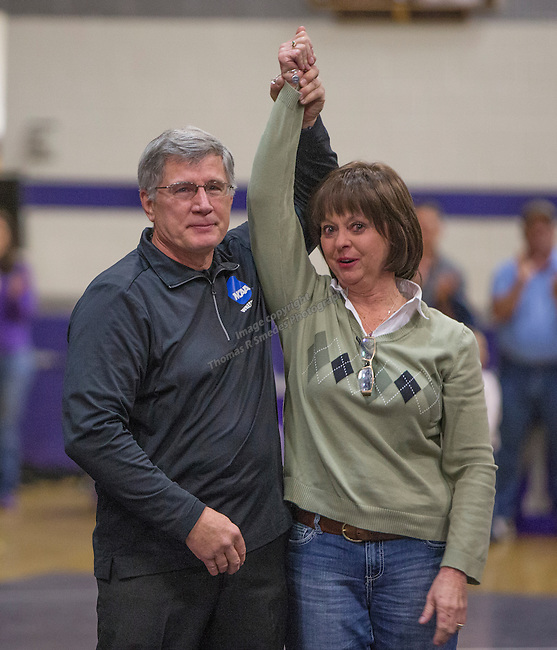 Longtime wrestling referee Les Rasmussen raises his wife Penny's arm.  He will be retiring after the season.  Rasmussen referred the NIAA Division I Northern Region Wrestling Championships held at Spanish Springs High School on Saturday, Feb. 13, 2016.