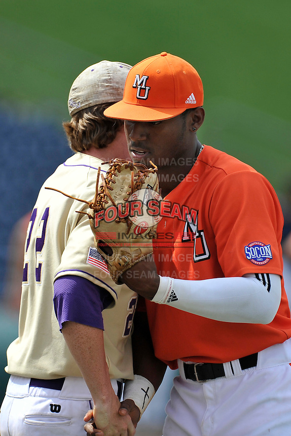 Center fielder Kyle Lewis (20) of the Mercer Bears shakes hands with Korey Anderson (22) after winning a SoCon Tournament game against Western Carolina on Saturday, May 28, 2016, at Fluor Field at the West End in Greenville, South Carolina. Mercer won, 9-8. (Tom Priddy/Four Seam Images)