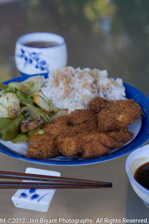Japanese cuisine, Boneless fried chicken breast tenders, vegetable stir fry and rice. ©2012. Jim Bryant Photo. All Rights Reserved.