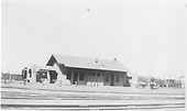 View of the east side of the AT&amp;SF Santa Fe depot.  A passenger train is in the background, but not identifiable.<br /> AT&amp;SF  Santa Fe, NM  circa 1914