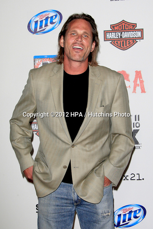 """LOS ANGELES - SEP 8:  Chris Browning arrives at the """"Sons of Anarchy"""" Season 5 Premiere Screening at Village Theater on September 8, 2012 in Westwood, CA"""